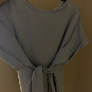 Light blue blouse with tie at the waist